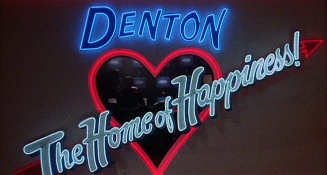 """The Neon Home of Happiness sign glows in """"Shock Treatment"""""""