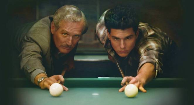 Fast Eddie Felson and his young protege Vincent line up shots on a green pool table