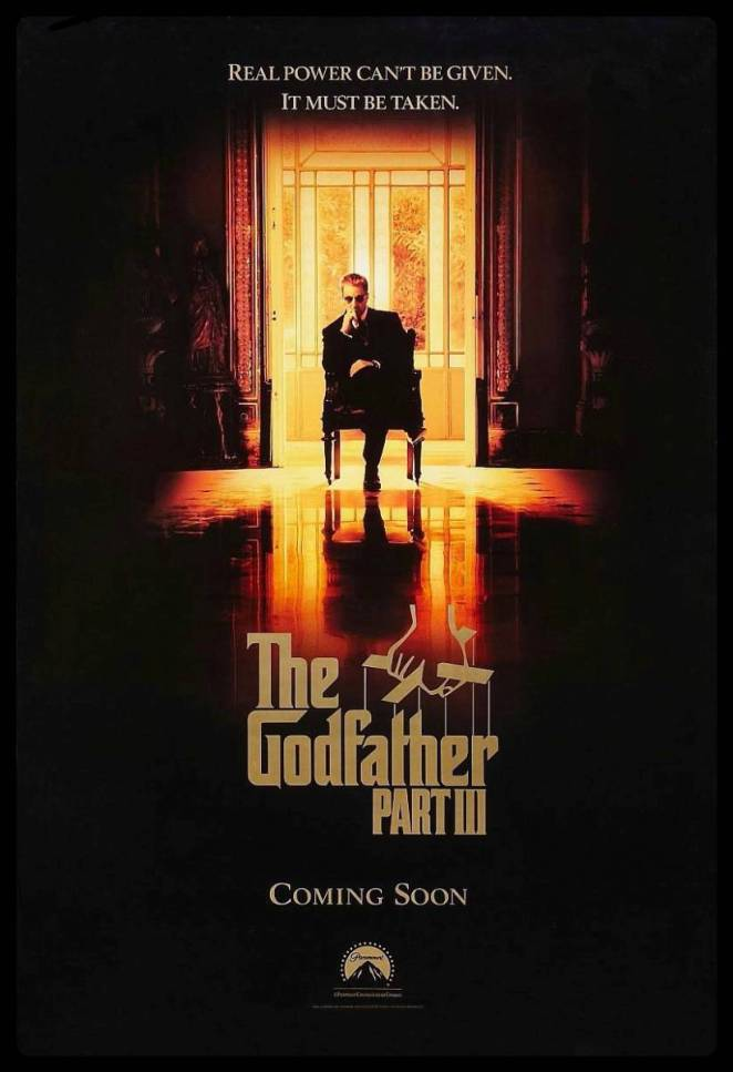 Michael Corleone sits alone in the middle of a dark room as gloden light from outside fills his space