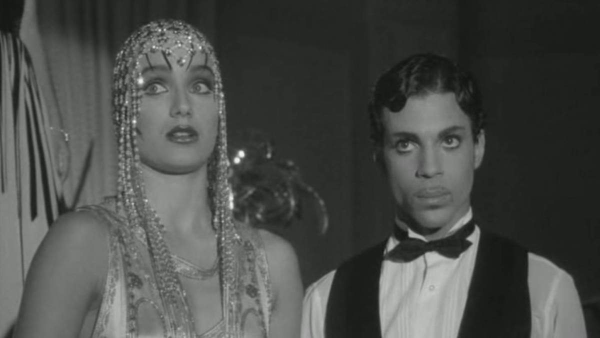 Mary Sharon (Kristin Scott Thomas) and Christopher Tracy (Prince) look off into the distance in Under the Cherry Moon.