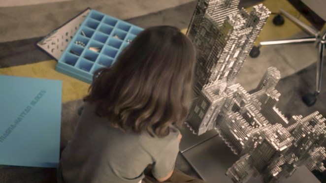 Watchmen S1E2 - Topher plays with his Magna-Hattan Blocks set, building a floating castle.