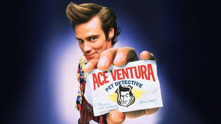 Ace holds his business card, bearing the title of the film, up to the camera