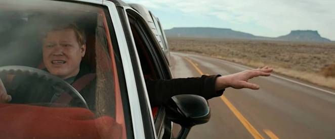 Todd sings along to the radio and sticks his hand out the window of the El Camino as he drives through the desert