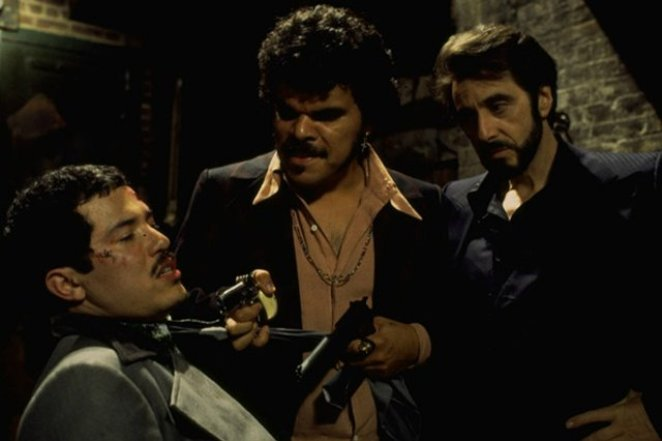 Carlito and Pachanga grab Benny Blanco in a back alley and threaten him with a gun