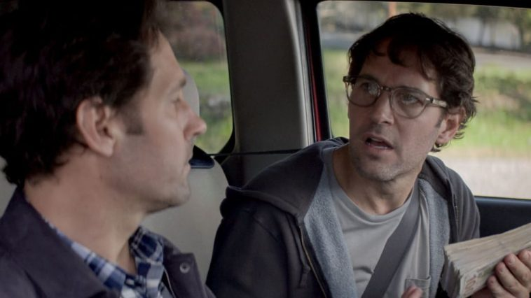 The two versions of Miles (Paul Rudd) sit in a car in Living with Yourself