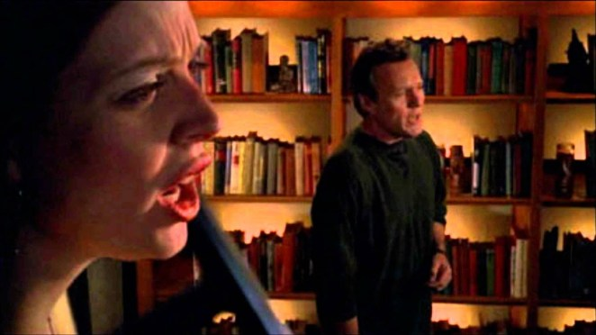 Tara and Giles sing about leaving the gang whilst surrounded by magic books