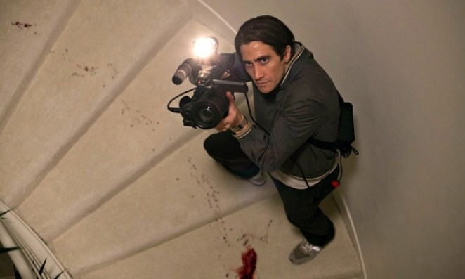 Lou Bloom films as he walks through a crime scene of a home invasion with blood spilled on the stairs