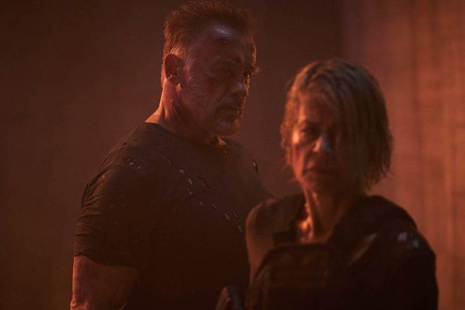 The T-800 looks at Sarah Conner in a red room