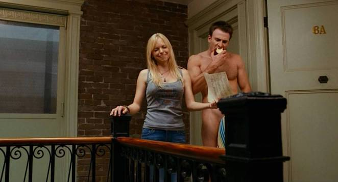 Ally looks away from a nearly naked Colin as she gives him her list of guys