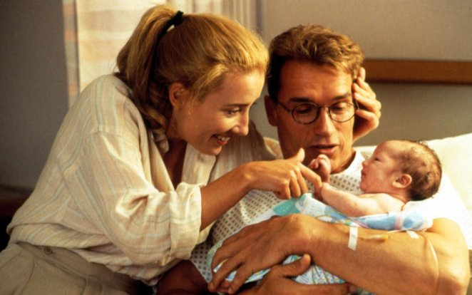 Diana and Alex, in his hospital bed, holding Junior and looking overjoyed.