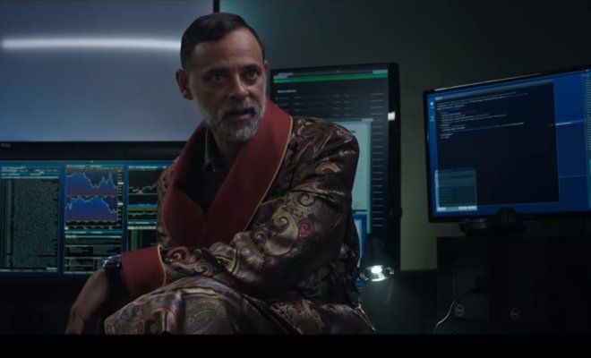 Alexander Siddig sits in front of computers talking