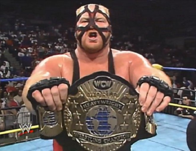 Vader holding the WCW heavyweight championship belt