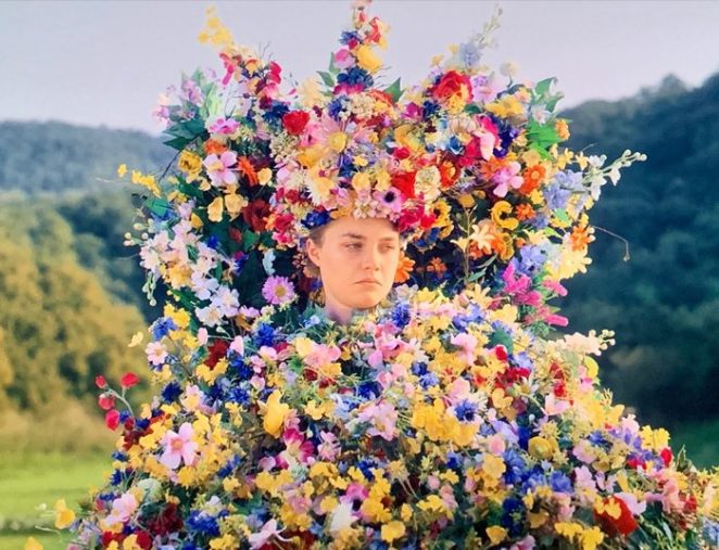 May Queen Dany looks sad covered in vivid flowers