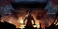 The game's protagonist, Sekiro, stands with his back to the camera holding his katana, facing a burning building