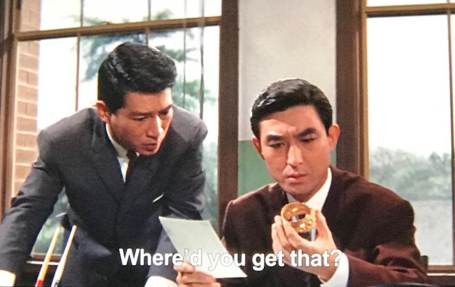 Shindo from Ghidorah looking at the Princess's golden bracelet
