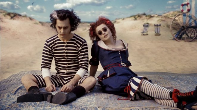 Sweeney and Mrs Lovett by the sea, in bathing dresses. She is happy, he is brooding.