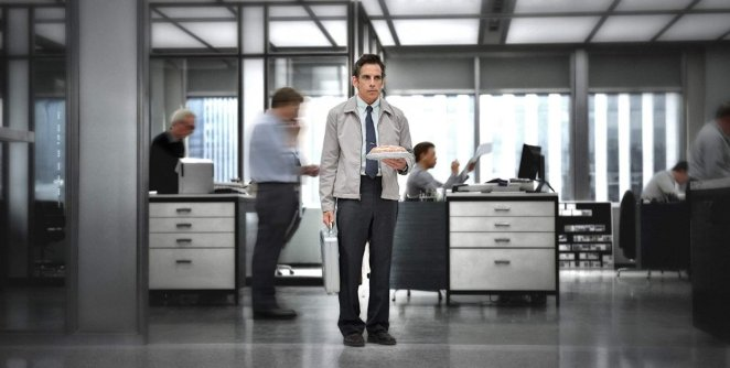 The world blurs by Walter Mitty as he stands in an office and stares off in a daydream in
