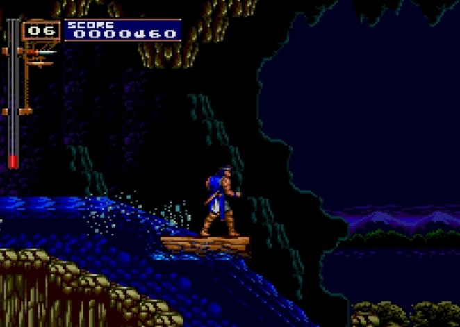 Richter stands on a raft going down a waterfall near a cave.