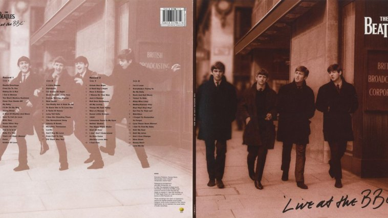 John, Paul, George and Ringo walk down the street into the BBC offices.