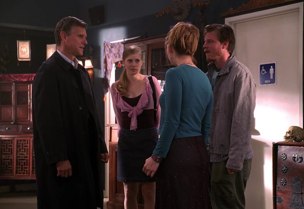 Tara greets her father, brother and cousin. They all look uncomfortable.