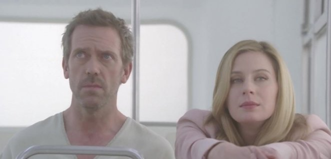 House and Amber sit side by side on a bus