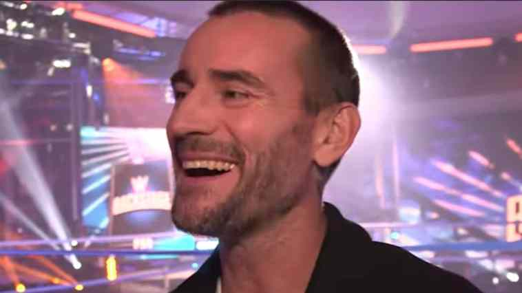 A smiling CM Punk is on the set of WWE Backstage on his return.