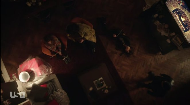 Dom lies stabbed on the floor while Janice looms and Darlene is tied up