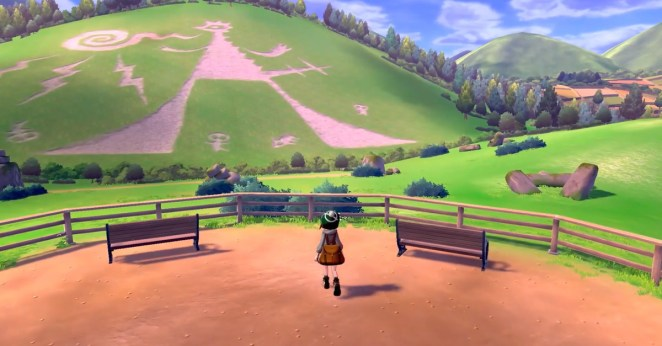 the player in pokemon sword and shield looking out onto a hill where a massive drawing was made thousands of years ago