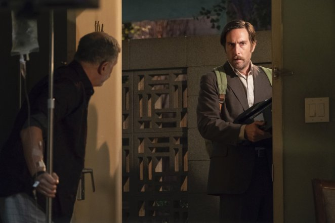 Bracamonte answers the door of Room 104 to Brandon