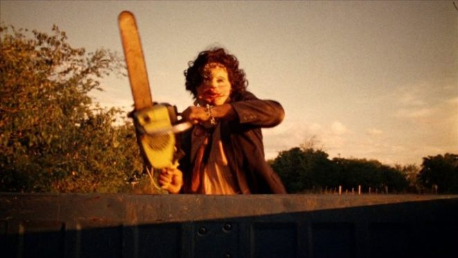 Leatherface chases a truck that's driving away