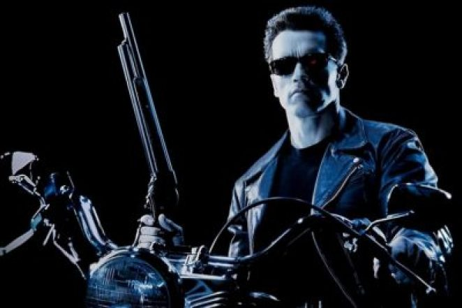 Arnold Schwarzenegger's terminator on a motorcycle, holding a shotgun and wearing sunglasses