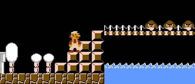 Mario stands before a bridge where three Goombas approach.