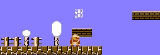 Super Mario slides under a brick and racks up coins.