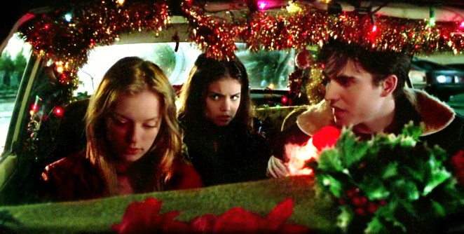 Ronna, Claire and Manny sit in a car outside Todd's house planning a drug buy