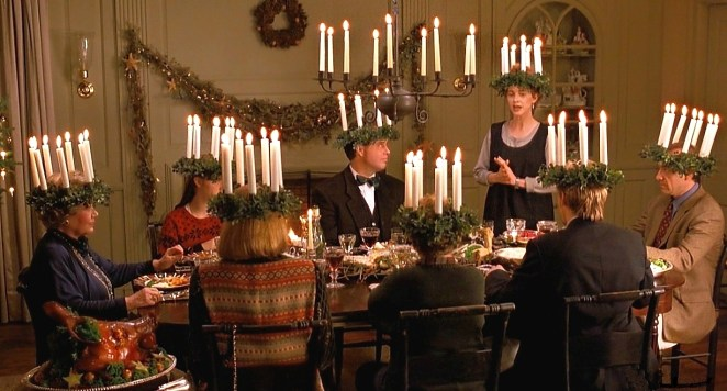 Gus sits at a table with the Chasseur family during a Christmas eve ritual