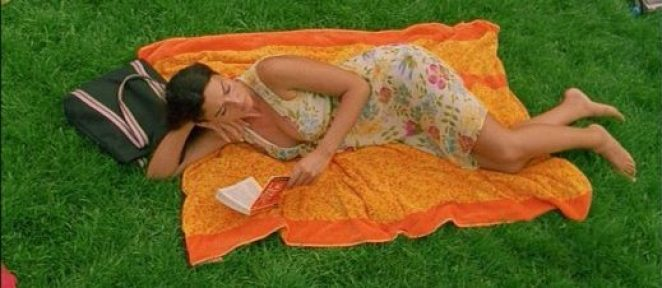 Alex in Irreversible, lying on the grass reading at the end of the film.
