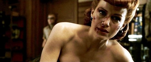 Sally Jupiter in the Zack Snyder Watchmen film with a bloodied face after being sexually assaulted