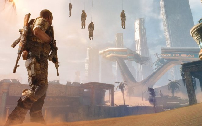 Captain Walker stands on the sand ridden streets of Dubai while buried skyscrapers and hanging corpses loom in the background.