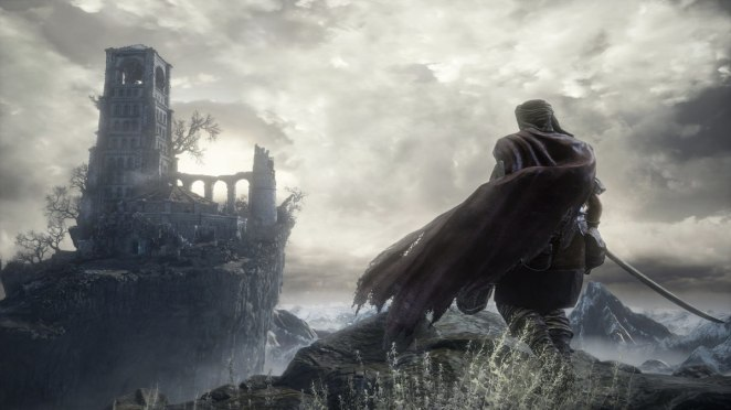 A figure in a cape stands atop a cliff looking at a small fort off in the distance against a gray, stormy sky