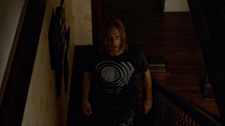 Ethan Embry's character in the Devil's Candy walks slowly up some stairs