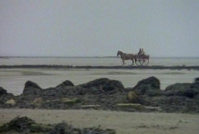 A pony and trap travel along the causeway to Eel Marsh House