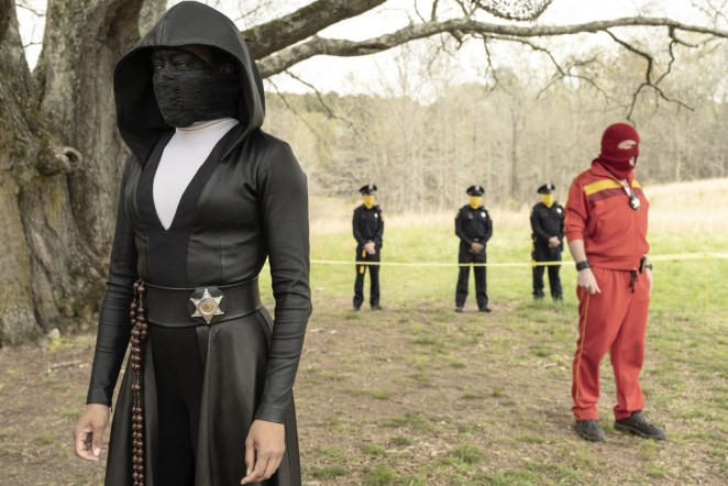 Sister Night and Red Scare assess a crime scene with masked police