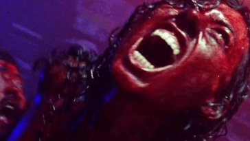 Desi screaming while covered in blood.