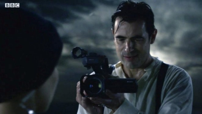 Dracula holds a camcorder