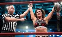 Tessa Blancard holding her new wrestling belt