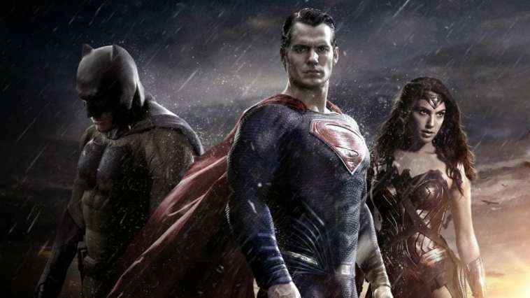Batman, Superman and Wonder Woman standing side by side.