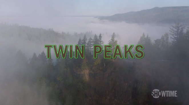 Overhead shot of mountain forest, with Twin Peaks logo superimposed