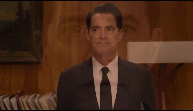 Dale Coopers disembodied head is superimposed over Cooper as stands in the Twin Peaks Sheriffs Office