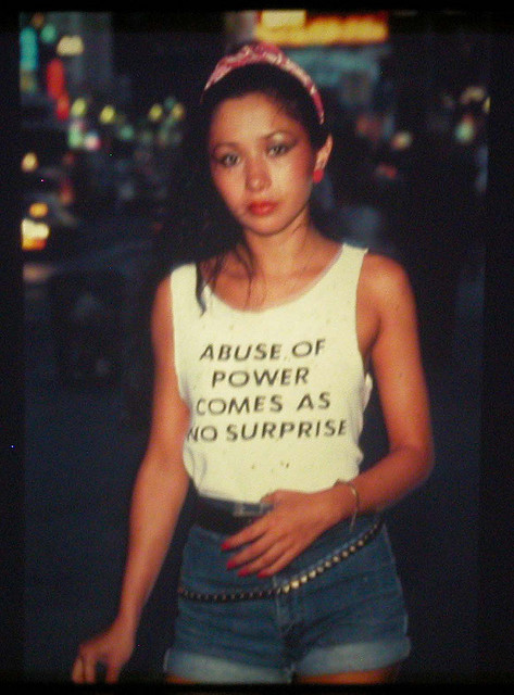 """sarahdeetz: This is Lady Pink, one of the only female graffiti artists active in the '80s. Jenny Holzer, famous for her feminist postmodern """"Truisms,"""" designed this shirt and Lady Pink wore it around NYC. WOAH how did i go this long without knowing the story behind one of my favourite photographs of all time?!"""