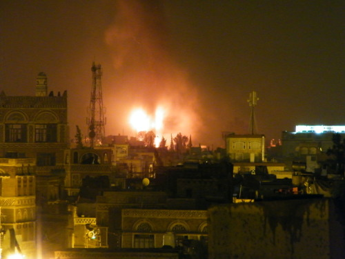 The scene from my roof at about 22:20 hrs local. Buildings burn in Hasaba, Sana'a as heavy fighting continues. (The building on fire is Yemen's national airline, Yemenia, HQ)
